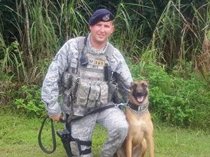 USAF SSgt Terry White and MWD Hattie in Guam