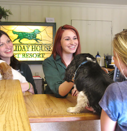 Front desk staff welcoming a dog and its owner